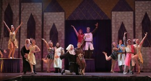 "King Arthur (Michael Chartier) and the Lady of the Lake (Christine Paccillo) and members of the ""Spamalot"" company"