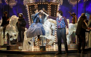 Alexis Gordon as Julie Jordan, Jonathan Winsby as Billy Bigelow, and the gleaming Carousel
