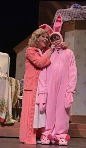 Mom (Jennifer Grasso) is amused; Ralphie (Tyler Sautner) not so much